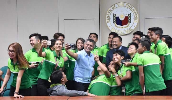 Senator JV Ejercito shares a light moment with members of the Federation of Student Councils of Oriental Mindoro